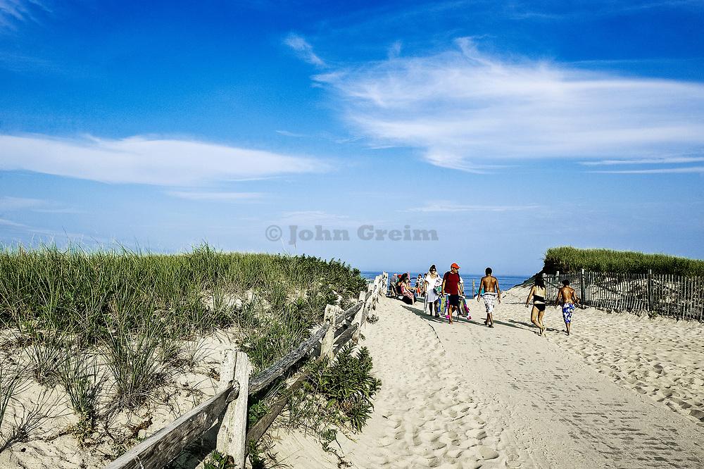 Vacationers walk to the beach along sandy path, Nauset Beach, Cape Cod, MA, USA
