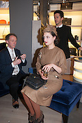 CHARLES BURNS DOING A CUT-OUT OF ADELLE MILDRED, Smythson Sloane St. Store opening. London. 6 February 2012.