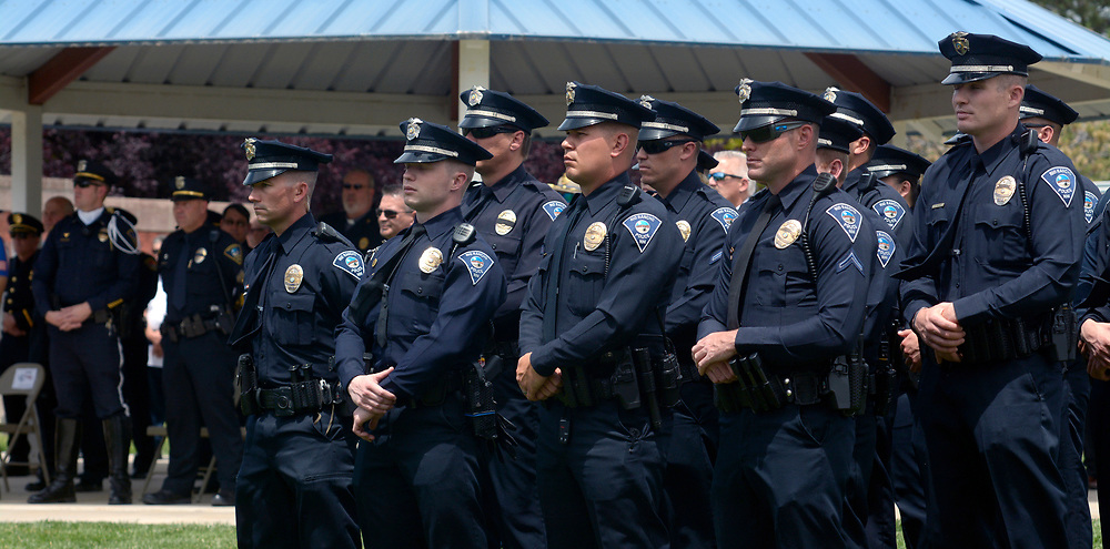 gbs052517e/RIO-WEST -- Rio Rancho Police Officers stand in formation during the Memorial Service honoring officers who have died in the line of duty at the Rio Rancho Memorial Park on Thursday, May 25, 2017. (Greg Sorber/Albuquerque Journal)