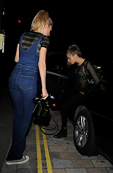 Model Cara Delevingne and sister Poppy Delevingne head out for a night out at the Chiltern Firehouse in London, UK. 03/10/2014<br />BYLINE MUST READ : GOTCHAIMAGES.COM<br /><br />Copyright by © Gotcha Images Ltd. All rights reserved.<br />Usage of this image is conditional upon the acceptance <br />of Gotcha Images Ltd, terms and conditions available at<br />www.gotchaimages.com