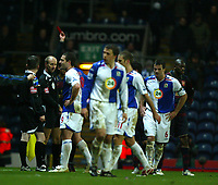 Photo: Paul Greenwood/Sportsbeat Images.<br />Blackburn Rovers v Arsenal. Carling Cup, Quarter Final. 18/12/2007.<br />Referee Mike Riley (2nd L) shows Arsenal's Denilson (unseen) the red card