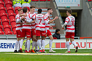 Doncaster Rovers celebrate as Doncaster Rovers Forward John Marquis (9) scores goal 1-0 during the EFL Sky Bet League 1 match between Doncaster Rovers and Bristol Rovers at the Keepmoat Stadium, Doncaster, England on 27 January 2018. Photo by Craig Zadoroznyj.