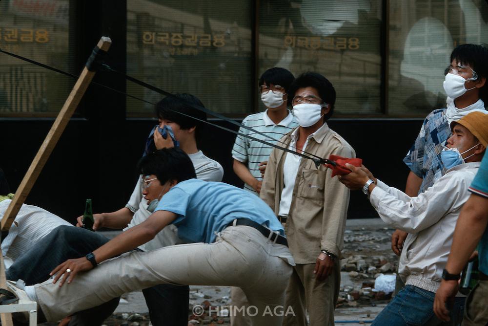 Seoul, Korea. Students catapulting Molotov cocktails.