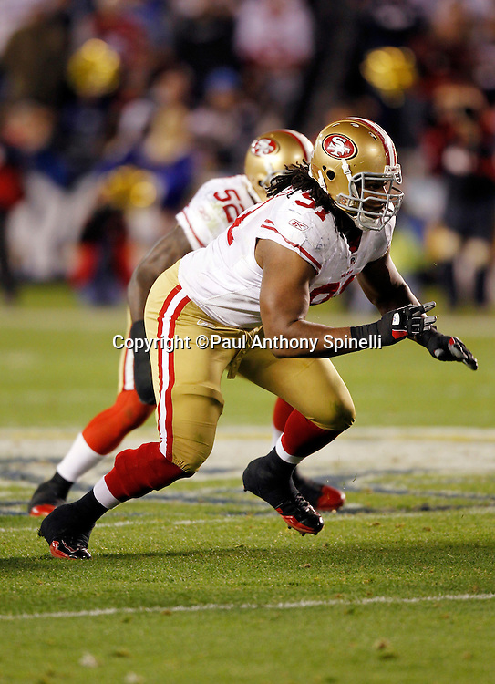 San Francisco 49ers defensive tackle Ray McDonald (91) rushes the quarterback during the NFL week 15 football game against the San Diego Chargers on Thursday, December 16, 2010 in San Diego, California. The Chargers won the game 34-7. (©Paul Anthony Spinelli)