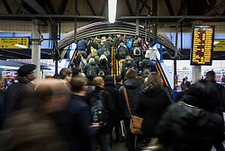 CAPTION CORRECTION © Licensed to London News Pictures. 19/12/2016. London, UK. Passengers head for the exit at Clapham Junction. Some Southern Rail services are running today as ASLEF union drivers started a two day strike in a dispute over driver-only operated trains. Photo credit: Peter Macdiarmid/LNP