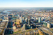 Nederland, Noord-Holland, Amsterdam, 11-12-2013; zicht op de Zuidas met in het midden de A10 met hoofdkantoor ABN-AMRO. Verder in beeld de woontorens Symphony 1 en 2 (onderdeel Gershwin), de Vinoly-toren en Ito-toren (onderdeel Mahler4). Aan de andere kant van de ringweg Zuid Station Zuid-WTC, World Trade Centre (WTC). Foto richting Nieuwe Meer, Schiphol aan de verre horizon.<br /> Zuid-as, 'South axis', financial center in the South of Amsterdam, with headquarters of former ABN AMRO. Amsterdam equivalent of 'the City', financial district. <br /> luchtfoto (toeslag op standaard tarieven);<br /> aerial photo (additional fee required);<br /> copyright foto/photo Siebe Swart.