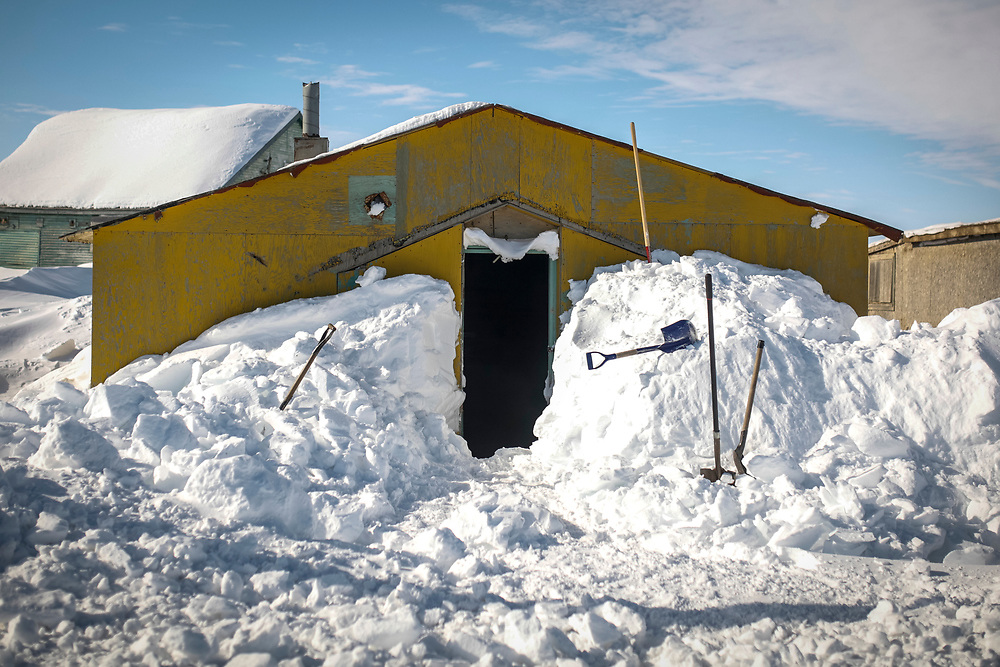 A building is shovelled out in Tuktoyaktuk.