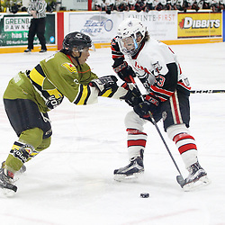 "TRENTON, ON  - MAY 4,  2017: Canadian Junior Hockey League, Central Canadian Jr. ""A"" Championship. The Dudley Hewitt Cup. Game 5 between Powassan Voodoos and the Georgetown Raiders.  Bo Peltier #6 of the Powassan Voodoos checks Jack Jacome #23 of the Georgetown Raiders during the first period.<br /> (Photo by Tim Bates / OJHL Images)"