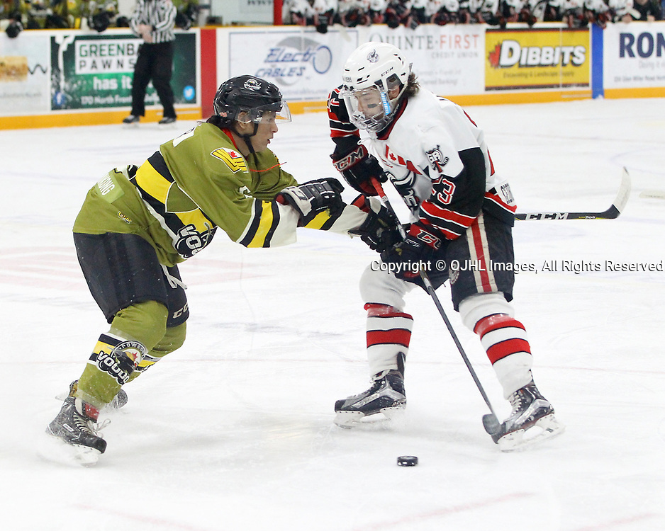 TRENTON, ON  - MAY 4,  2017: Canadian Junior Hockey League, Central Canadian Jr. &quot;A&quot; Championship. The Dudley Hewitt Cup. Game 5 between Powassan Voodoos and the Georgetown Raiders.  Bo Peltier #6 of the Powassan Voodoos checks Jack Jacome #23 of the Georgetown Raiders during the first period.<br /> (Photo by Tim Bates / OJHL Images)