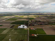 Nederland, Noord-Holland, Gemeente Wieringermeer, 16-04-2012. Wieringermeer, met Kreileroord in de voorgrond en Wieringerwerf op het tweede plan. Amstelmeer rechts aan de horizon...Wieringmeer polder,  newly created land 1927, part of the Zuiderzee Works..luchtfoto (toeslag), aerial photo (additional fee required);.copyright foto/photo Siebe Swart