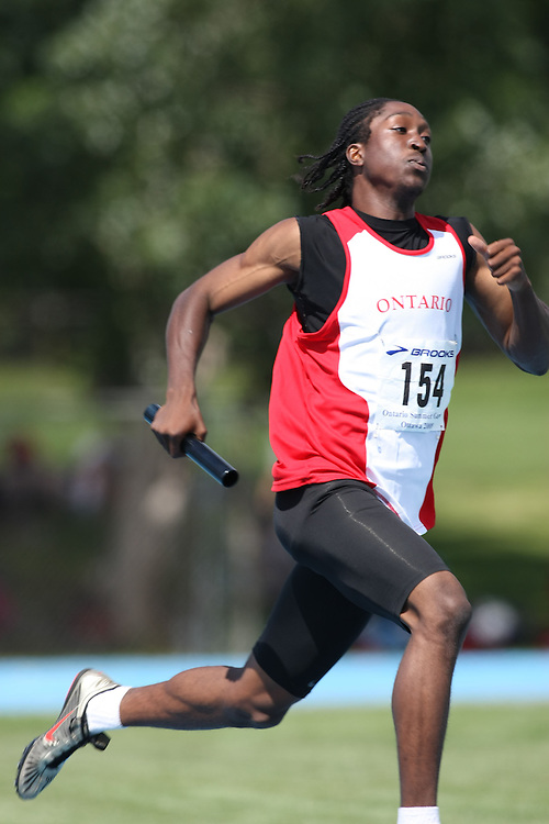 (Ottawa, Ontario---15 August 2008)  Gordon Cave of Ontario White competing in the 4x400m relay at the 2008 Ontario Summer Games and Ontario v. Quebec v. Atlantic Canada Espoire Meet. Photo copyright Sean Burges/Mundo Sport Images. More details can be found at www.msievents.com.