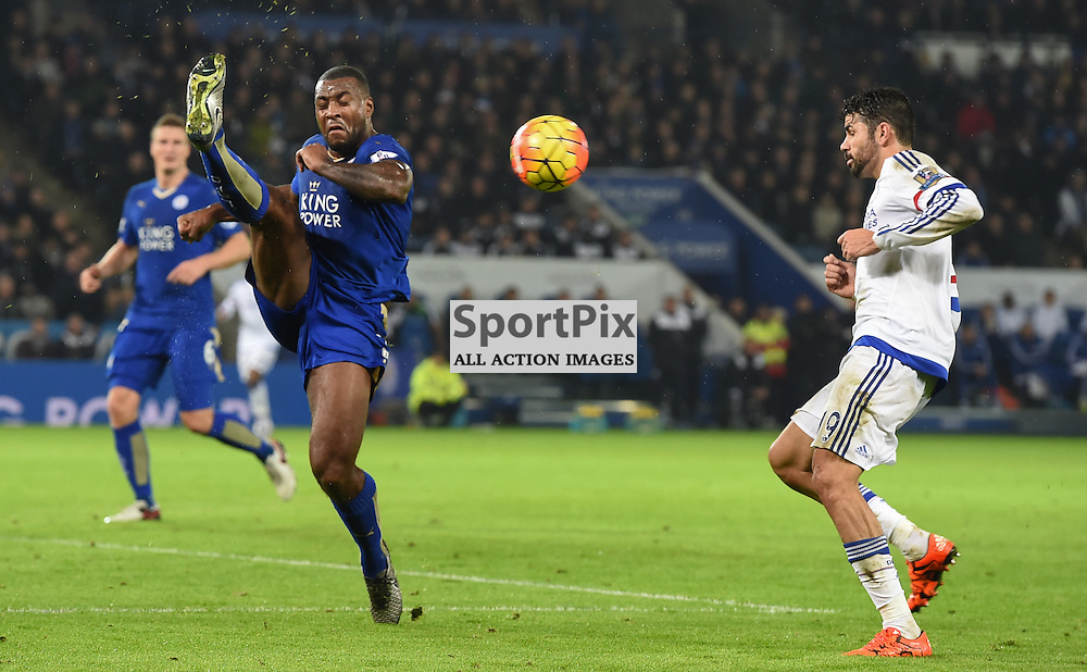 Wes Morgan gets the ball away under pressure from Diego Costa (c) Simon Kimber | SportPix.org.uk