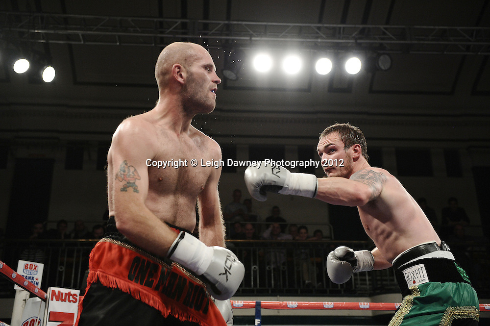 Miles Shinkwin (green/black shorts) defeats Jody Meikle in a Light Heavyweight contest at York Hall, Bethnal Green, London on the 1st Novemeber 2012. Frank Warren Promotions. © Leigh Dawney Photography 2012.