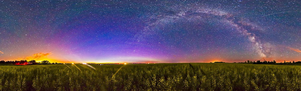 The summer Milky Way over a ripending canola field, July 6, 2013, from home in southern Alberta. This is a stitch of 8 x 60 second exposures with the Canon 5D MkII at ISO 4000 and Sigma 8mm lens at f/3.5. Colour and contrast have been boosted a lot, and shadow detail brought out a lot in the foreground.