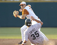 Texas shortstop Seth Johnston (2) gets ready to throw to first after forcing out Tulane's Micah Owings (35) in the sixth inning.  Texas defeated Tulane 5-0 in the second round of the College World Series at Rosenblatt Stadium in Omaha, Nebraska on June 20, 2005.