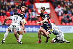 Jason Woodward offloads to Will Hurrell of Bristol Rugby as Paul Grant of Bath Rugby tackles - Rogan Thomson/JMP - 26/02/2017 - RUGBY UNION - Ashton Gate Stadium - Bristol, England - Bristol Rugby v Bath - Aviva Premiership.