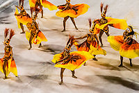 Dancers perform in the Carnaval parade of Academicos da Rocinha samba school in the Sambadrome, Rio de Janeiro, Brazil.