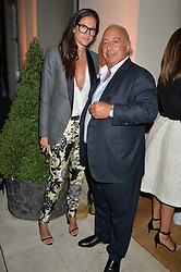 JENNA LYONS J. Crew creative director and SIR PHILIP GREEN at a party hosed by the US Ambassador to the UK Matthew Barzun, his wife Brooke Barzun and editor of UK Vogue Alexandra Shulman in association with J Crew to celebrate London Fashion Week held at Winfield House, Regent's Park, London on 16th September 2014.