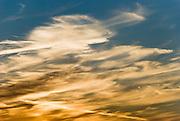 Orange, white, and blue sky at sunset over Kingston on the Kitsap Peninsula, Washington.