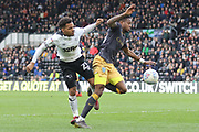 Derby County midfielder Duane Holmes and Sheffield Wednesday midfielder Rolando Aarons collide during the EFL Sky Bet Championship match between Derby County and Sheffield Wednesday at the Pride Park, Derby, England on 9 March 2019.