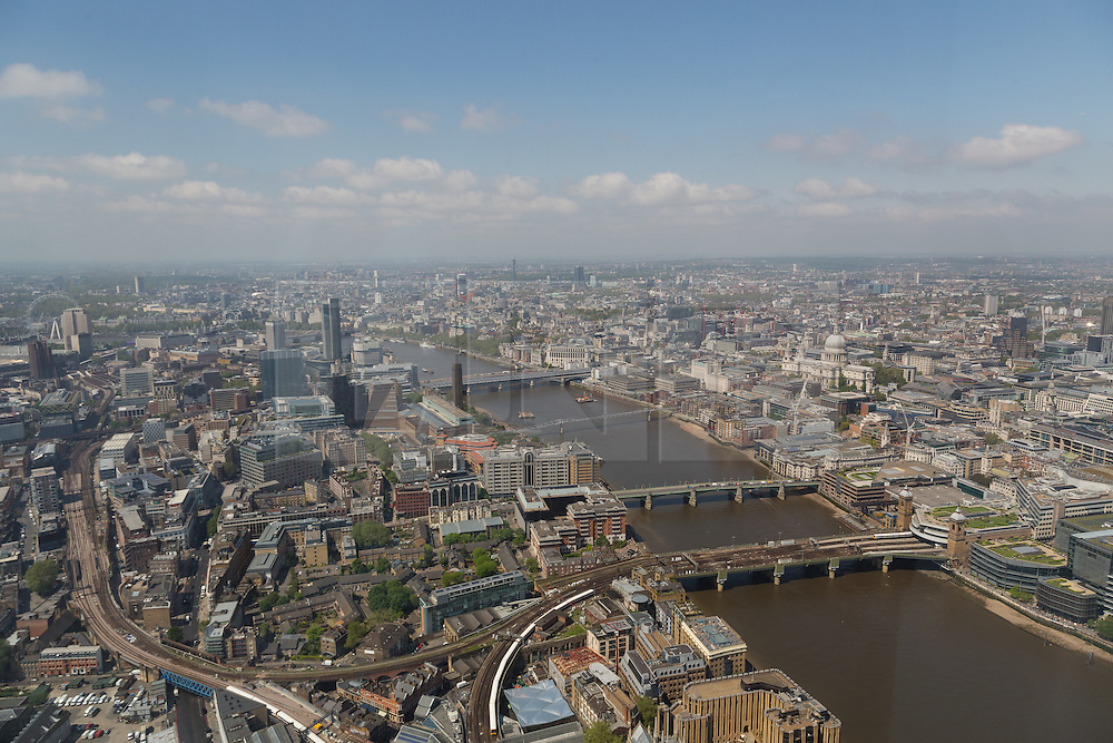 © Licensed to London News Pictures. 13/06/2016. LONDON, UK.  An aerial view of London showing St Paul's Cathedral, the London Eye and the River Thames during sunny spring weather today. Haze and pollution is seen hanging towards the horizon.  Photo credit: Vickie Flores/LNP