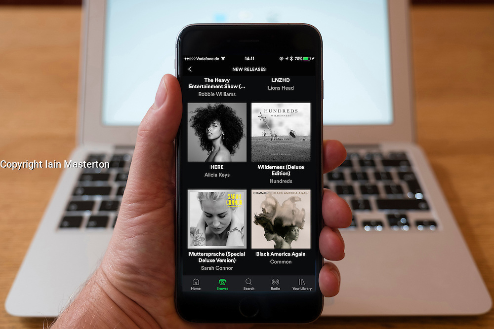 Using iPhone smartphone to display Spotify music streaming service