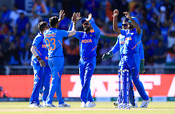 India's Jasprit Bumrah (second left) celebrates taking the wicket of West Indies' Carlos Brathwaite, caught by MS Dhoni (obscured), during the ICC Cricket World Cup group stage match at Emirates Old Trafford, Manchester.