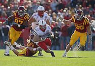 November 06 2010: Nebraska Cornhuskers running back Rex Burkhead (22) is pulled down by Iowa State Cyclones defensive end Jacob Lattimer (48) during the first half of the NCAA football game between the Nebraska Cornhuskers and the Iowa State Cyclones at Jack Trice Stadium in Ames, Iowa on Saturday November 6, 2010. Nebraska defeated Iowa State 31-30.