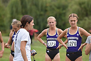 Washington Huskies director of track and field Maurica Powell (center) gives a post race to the women's cross country team after the UW/Seattle University Open at Warren G. Magnuson Park., Friday, Aug. 30, 2019, in Seattle. (Paul Merca/Image of Sport)