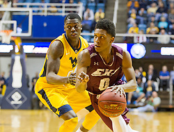Dec 21, 2015; Morgantown, WV, USA; Eastern Kentucky Colonels guard Dujuanta Weaver (0) dribbles past West Virginia Mountaineers guard Teyvon Myers (0) during the first half at the WVU Coliseum. Mandatory Credit: Ben Queen-USA TODAY Sports