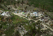 JABOUIN, HAITI - OCTOBER 18, 2016:  Jabouin is one of dozens of villages destroyed by Hurricane Matthew.  The Haitian government is  insisting on coordinating aid this time around. After the 2010 earthquake, aid groups took over. They worked around a government as devastated as its capital, undermining billions of dollars in aid and the very people it was meant to help. For now, the government has put a stop to that. The lessons of wasted aid, and its duplicative and disorganized delivery, have grounded the government's belief that what is done this time must be sustainable. The government has instead asked all donors to funnel the goods they wish to bring in through customs, and then heed the direction of officials on where to take it.