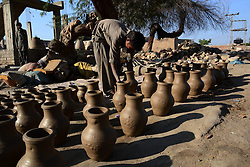 A Pakistani boy arranges pottery at a workshop in southern Pakistani port city of Karachi, Feb. 25, 2015. EXPA Pictures © 2015, PhotoCredit: EXPA/ Photoshot/ Arshad<br /> <br /> *****ATTENTION - for AUT, SLO, CRO, SRB, BIH, MAZ only*****