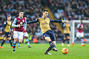 Arsenal's Laurent Koscielny on the ball during the Barclays Premier League match between Aston Villa and Arsenal at Villa Park, Birmingham, England on 13 December 2015. Photo by Shane Healey.