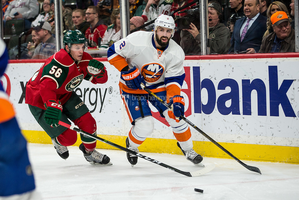 Dec 29, 2016; Saint Paul, MN, USA; New York Islanders defenseman Nick Leddy (2) passes around Minnesota Wild forward Erik Haula (56) during the second period at Xcel Energy Center. Mandatory Credit: Brace Hemmelgarn-USA TODAY Sports