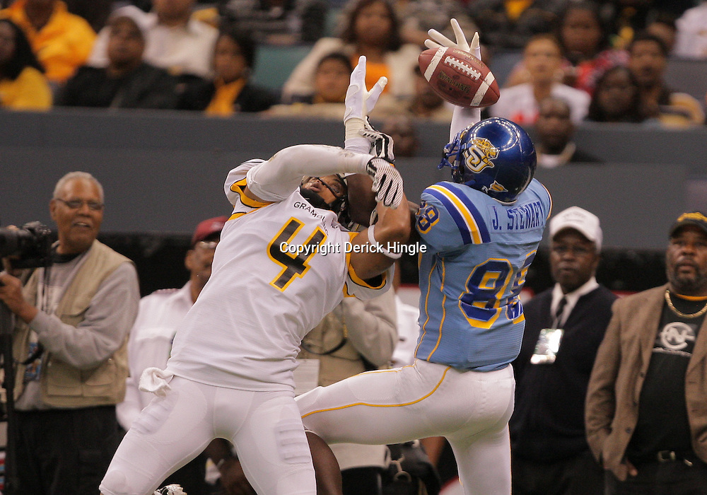 2008 November, 29: Southern University wide receiver Charles Booker (89) catches the ball as Grambling State defensive back Jeffrey Jack (4) defends the play during the first half of the 35th annual State Farm Bayou Classic between Southern University and Grambling State University at the Louisiana Superdome in New Orleans, LA.  .