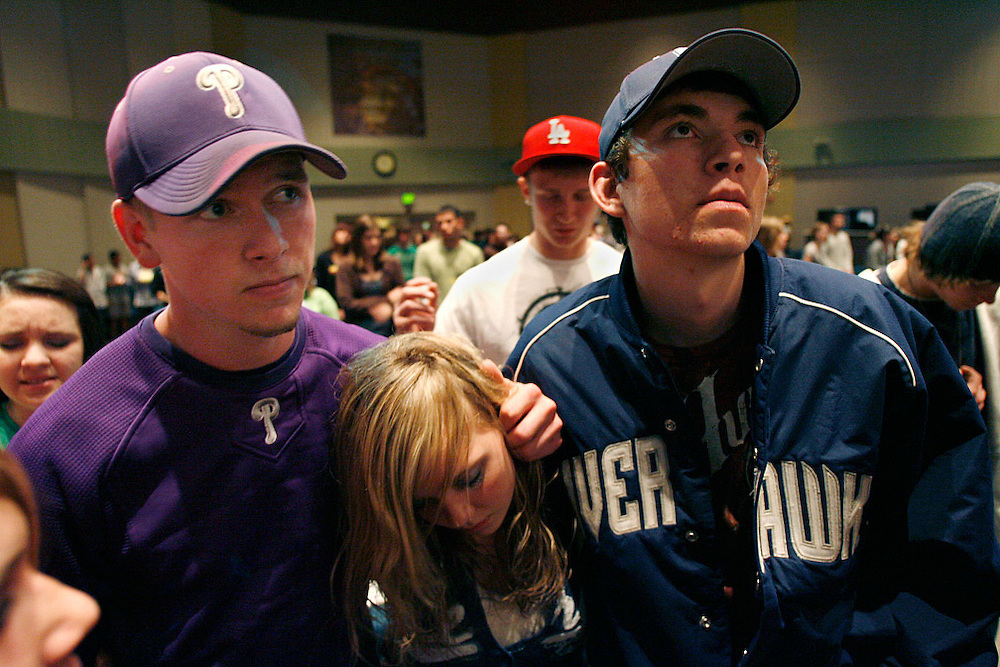 """Levi, left, and Luke -- both boasting their school colors --accompany their sister Bethany, 13, to a """"Night of Fire"""" church youth group activity. While baseball keeps them busy and out of trouble, """"They can't be playing baseball all the time,"""" said their father, Wayne."""