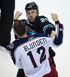 October 8, 2009; San Jose, CA, USA; San Jose Sharks right wing Ryane Clowe (29) and Columbus Blue Jackets right wing Michael Blunden (12) fight during the second period at HP Pavilion.  San Jose won 6-3. Mandatory Credit: Jason O. Watson / US PRESSWIRE