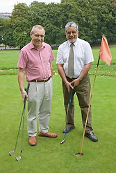 Couple of older men playing pitch and putt,