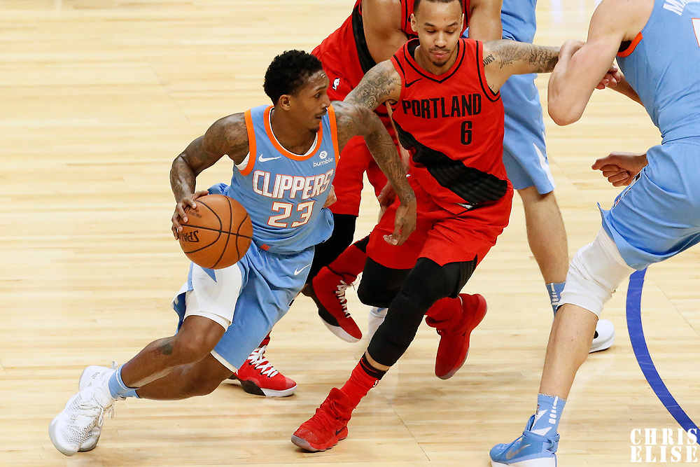 18 March 2018: LA Clippers guard Lou Williams (23) drives past LA Clippers center DeAndre Jordan (6) on a screen by LA Clippers center Boban Marjanovic (51) during the Portland Trail Blazers 122-109 victory over the LA Clippers, at the Staples Center, Los Angeles, California, USA.