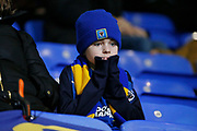 A young Wimbledon fan during the EFL Sky Bet League 1 match between Bolton Wanderers and AFC Wimbledon at the University of  Bolton Stadium, Bolton, England on 7 December 2019.