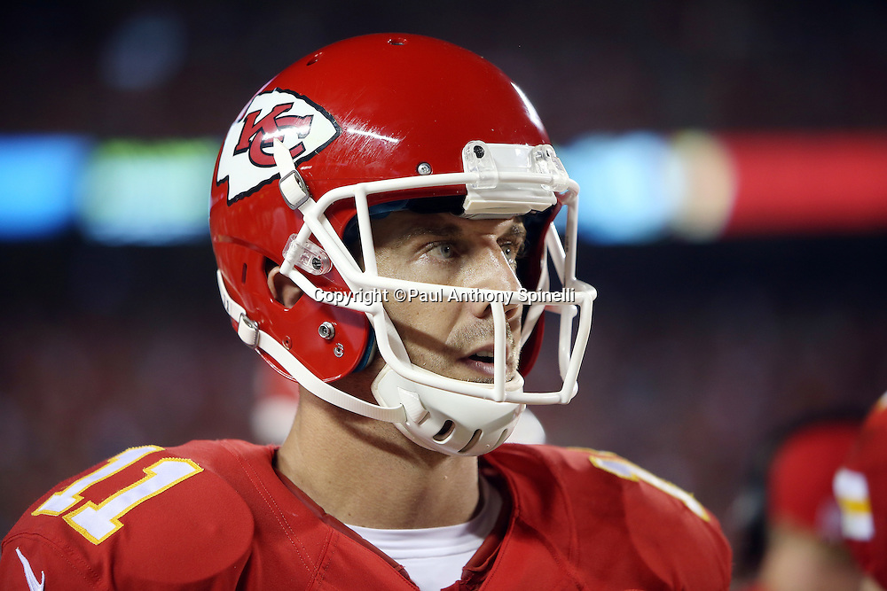 Kansas City Chiefs quarterback Alex Smith (11) looks on during the NFL week 4 regular season football game against the New England Patriots on Monday, September 29, 2014 in Kansas City, Mo. The Chiefs won the game 41-14. ©Paul Anthony Spinelli