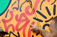 "2 August, 2008. New York, NY. Angel Ortiz, 41, a graffiti artist who collaborated with Keith Haring in the 80's, is here showing the tag he made on July 22nd 2008 on Keith Haring mural of Bowery and Houston street. Next to him, on the left, is Clayton Patterson, born in 1948, who helped Angel Ortiz with the graffiti. Angel Ortiz tagged his nickname ""LA2"", which refers to ""Little Angel"", on the Keith Haring mural that was reproduced on May 4th 2008, after the original 1982 graffiti was painted over. Angel Ortiz asked Clayton Patterson, an artist and gallerist, to help him tag the wall with his own artwork. Mr. Ortiz has accused the Haring Foundation of denying him credit on many of the jointly produced works.  The two artists met in 1980, when Angel Ortiz was 13 years old. Subsequently, Ortiz and Haring collaborated for several years and had joint shows. <br />  ©2008 Gianni Cipriano for The New York Times<br /> cell. +1 646 465 2168 (USA)<br /> cell. +1 328 567 7923 (Italy)<br /> gianni@giannicipriano.com<br /> www.giannicipriano.com"