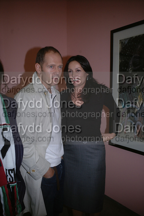 Paul and Trisha Simonon. JAKE AND DINOS CHAPMAN'S ' Like a dog returns to its vomit' White Cube, Hoxton Sq and afterwards at Vic Naylor's. St. John St. London.   18 October 2005. ONE TIME USE ONLY - DO NOT ARCHIVE © Copyright Photograph by Dafydd Jones 66 Stockwell Park Rd. London SW9 0DA Tel 020 7733 0108 www.dafjones.com