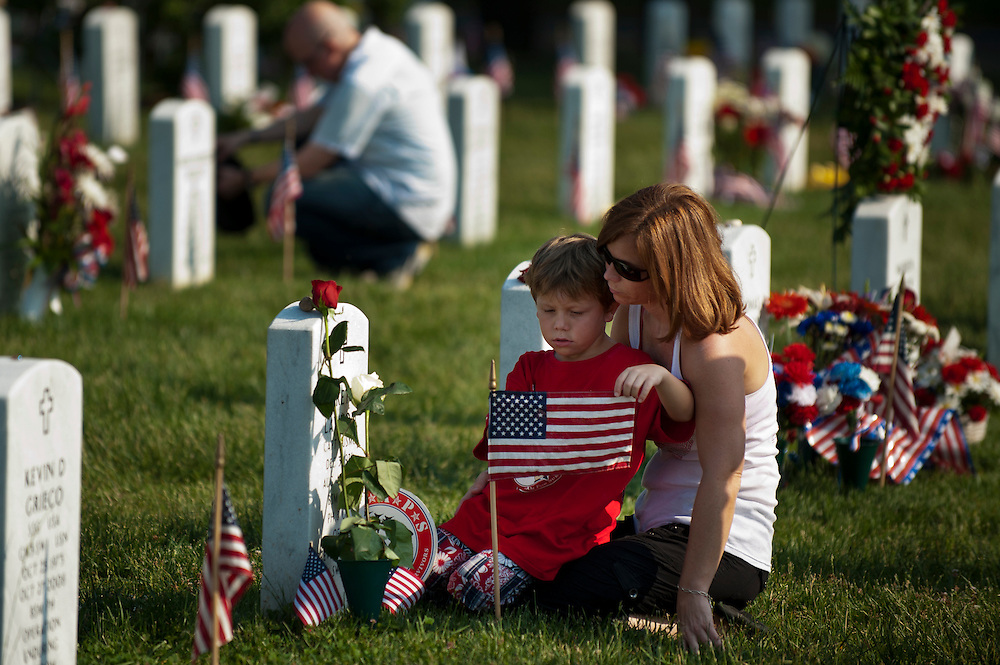 TRISHA LAWTON and her son CADEN sit next to the grave of husband and father, Marine Capt. Garrett T. Lawton on Memorial Day in Arlington National Cemetery's Section 60. Lawton, of Charleston, W.Va., died in 2008 during Operation Enduring Freedom.