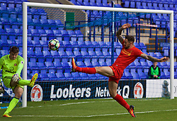 BIRKENHEAD, ENGLAND - Sunday, September 25, 2016: Liverpool's Danny Ings in action against Sunderland's goalkeeper Maksymilian Stryjek during the FA Premier League 2 Under-23 match at Prenton Park. (Pic by Concepcion Valadez/Propaganda)