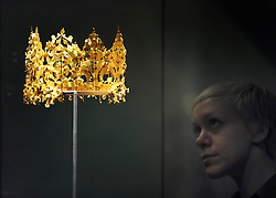 ©London News pictures. 01.03..2011. A woman looks at a gold crown from Tillya Tepe, Afghanistan, 1st century BC-1st century AD. A press view of Afghanistan: Crossroads of the Ancient World and Exhibition of treasures from the National Museum of Afghanistan on show at the British Museum today (Tuesday 1st March 2011). Picture Credit should read Stephen Simpson/LNP