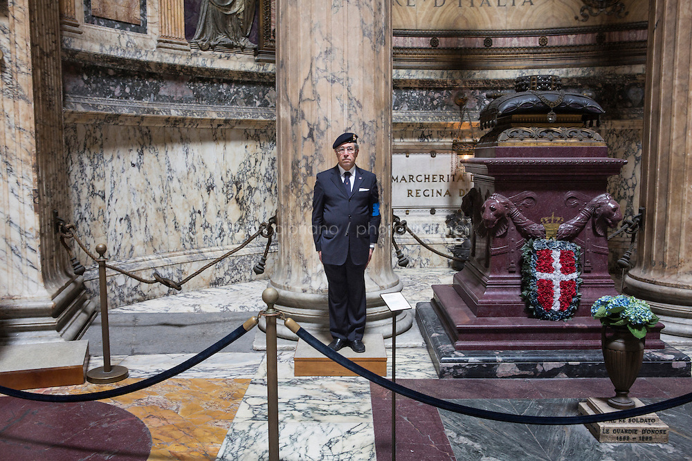 ROME, ITALY - 29 JULY 2014: Captain Ugo d'Atri, President of the National Institute for the Honor Guards to the royal tombs of the Pantheon, stands here by the tomb of King Victor Emmanuel II  in Rome, Italy, on July 29th 2014.<br /> <br /> The National Institute for the Honor Guards to the royal tombs of the Pantheon is a monarchic-oriented whose goal is to watch over the royal tombs at the Pantheon. Italy&rsquo;s first king, Vittorio Emanuele II and his son Umberto I, as well as Umberto's wife Queen Margherita are entombed in the Pantheon.