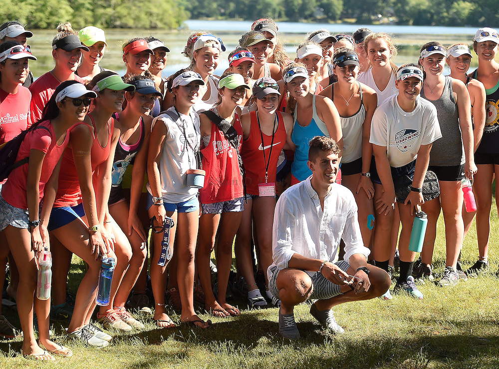 7/3/16 :: SPORTS :: FULKERSON :: Old Lyme native Austin Hack poses for a photo with participants in a USA Rowing Junior Nationals summer camp hosted at Rogers Lake in Old Lyme Sunday, July 3, 2016. Hack will be rowing as a member of the U.S. National Team in the Rio Olympics next month and was home on a rare two-day break from training with the team in Princeton, NJ. (Sean D. Elliot/The Day)