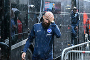 Bruno Saltor (2) of Brighton and Hove Albion gets off the team bus in the pouring rain on arrival at the Vitality Stadium before the Premier League match between Bournemouth and Brighton and Hove Albion at the Vitality Stadium, Bournemouth, England on 15 September 2017. Photo by Graham Hunt.