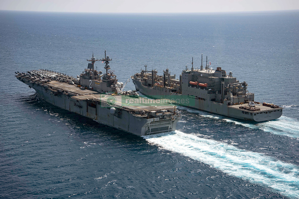 SULU SEA (Aug. 16, 2018) The Wasp-class amphibious assault ship USS Essex (LHD 2) participates in a replenishment-at-sea with the Lewis and Clark-class dry cargo and ammunition ship USNS Washington Chambers (T-AKE 11) during Cooperation Afloat Readiness and Training (CARAT) 2018. CARAT Malaysia, in its 24th iteration, is designed to enhance information sharing and coordination, build mutual warfighting capability and support long-term regional cooperation enabling both partner armed forces to operate effectively together as a unified maritime force. (U.S. Navy photo by Mass Communication Specialist 3rd Class Jenna Dobson/Released)180816-N-RP442 -0514